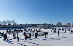 MUNICH – JANUARY 28: Families enjoying beautiful winter weather. In front of Schloss Nymphenburg castle in Munich, Germany Royalty Free Stock Photos