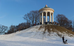 MUNICH – JANUARY 28: Monopteros building in English Garden, Muni. MUNICH – JANUARY 28: English Garden a large public park in the centre of Munich. Stretching Stock Photo