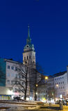 MUNICH – JANUARY 29: Night shot of St. Peter`s Church Peterskir. Che in Munich, Germany Stock Image