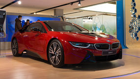 MUNICH – JANUARY 30: Red BMW i8 in BMW Welt. People looking at the car Stock Image