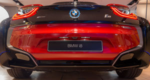 MUNICH – JANUARY 30: Red BMW i8 in BMW Welt. Rear shot. stock images