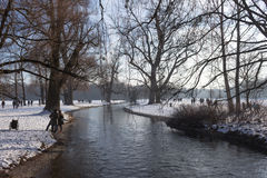 MUNICH – JANUARY 28: RIver in the park on a cold winter day. Peo. Ple enjoying sunny day Royalty Free Stock Photography