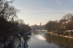 MUNICH – JANUARY 28: View on a city center from the bridge on ri. Ver Isar in Munich, Germany. View on St. Luke`s Church - the largest Roman Catholic church in Royalty Free Stock Images