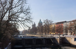 MUNICH – JANUARY 28: View on a city center from the bridge. On river Isar in Munich, Germany. View on St. Luke`s Church - the largest Roman Catholic church in Stock Photo