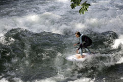 MUNICH - AUGUST 08: female surfer works the controversial Eisbach standing wave – Anniversary August 08, 2015 in Munich, germany Royalty Free Stock Photos