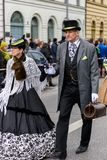 MUNICH, BAVARIA, GERMANY - MARCH 13, 2016: close up on couple dressed up as USA emigrated ancestors at the St. Patrick`s Day Para royalty free stock images