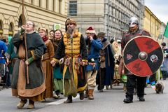 MUNICH, BAVARIA, GERMANY - MARCH 13, 2016: group of men and women dressed up as Mongolian worriers of the Middle Ages at the St. Patrick`s Day Parade stock photo