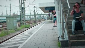 Munich Bayern, Germany, Europe - July 02 . 2018 Railway public Transport. Railway public Transport platform railway, railroad, people are waiting for S-bahn at stock footage