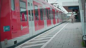 Munich Bayern, Germany, Europe - July 02 . 2018 Railway public Transport. Railway public Transport platform railway, railroad   S-bahn train arriving and stock video