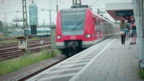 Munich Bayern, Germany, Europe - July 02 . 2018 Railway public Transport. Railway public Transport platform railway, railroad   S-bahn train arriving at Munich stock video footage