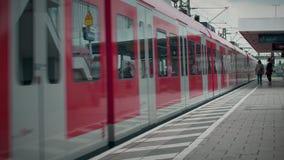 MUNICH BAYERN, GERMANY, EUROPE - JULY 02 . 2018 Railway public Transport. Railway public Transport platform railway, railroad   S-bahn train arriving at Munich stock video footage