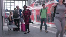 MUNICH, BAYERN GERMANY - JUN 01, 2018. Railway public Transport platform railway, railroad  Commuters,Travelers, Tourists waiting for the train in Germany at stock footage