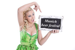 Munich beer festival. Woman with signboard in hands, isolated in white royalty free stock photos