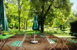 Munich, beer garden in popular bath. MUNICH, GERMANY -JUNE 11, 2018 Leisure time for drink and food at beer garden in Ungarerebad, one of the popular swimming stock images
