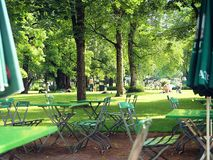 Munich, beer garden in popular swimming bath. MUNICH, GERMANY - Leisure time for drink and food at beer garden in Ungarerebad, one of the popular swimming baths stock image