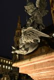 Munich central square by night, Germany. The German city of Munich at Christmas. , Marienplatz the central city square, by night. Mythological statue stock photo
