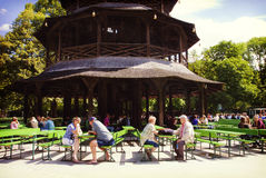 Munich - Chinese tower beer garden at Englisher Garten. MUNICH, GERMANY - Chinese tower beer garden at Englischer Garten in Munich offers visitors a traditional stock photos