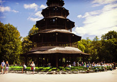 Munich - Chinese tower beer garden at Englisher Garten. MUNICH, GERMANY - Chinese tower beer garden at Englischer Garten in Munich offers visitors a traditional royalty free stock image
