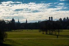 Munich Cityscape Bright Blue Cloudy Sky in Englisher Garten stock photo