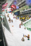 MUNICH, GERMANY – DECEMBER 24, 2009: Christmas decorations at Munich airport. In Germany. Decoration ski resort, gnomes skiing between Christmas trees stock photo