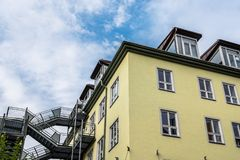 Low angle view of residential building in Munich. Munich, Germany - August 4, 2017: Low angle view of residential building in Munich Royalty Free Stock Image