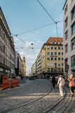 Scenic view of commercial street with luxury stores and a crowd Royalty Free Stock Image