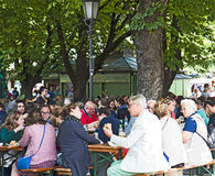 Munich, Germany - beer garden at Viktualien markt. Munich, Germany - Tourists and residents crowd the beer garden at Viktualien Markt for a refreshing pause stock photography