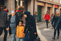 Free Munich, Germany, December 29, 2016: A Friendly Family Of Migrants Walks Down The Street In Munich. Tolerance Royalty Free Stock Photo - 93065025