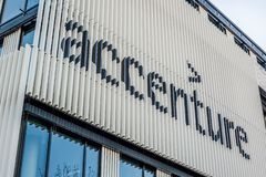Accenture logo at building in Munich, Germany. MUNICH, GERMANY - DECEMBER 26, 2018: Accenture logo at the company office building located in Munich, Germany stock photos