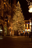MUNICH, GERMANY - DECEMBER 25, 2009: Christmas tree at night with lights. Royalty Free Stock Photo