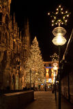 MUNICH, GERMANY - DECEMBER 25, 2009: Christmas tree at night wit. H lights. Marienplatz square in Munich, Germany. Marienplatz is a central square in the city royalty free stock images