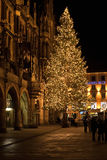 MUNICH, GERMANY - DECEMBER 25, 2009: Christmas tree at night wit Royalty Free Stock Photography