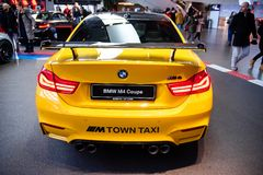 Munich, Germany - December 16, 2018: Exhibition of new models of cars at BMW Welt. BMW M4 coupe M Town taxi concept. royalty free stock photography
