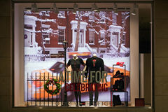 MUNICH, GERMANY - DECEMBER 25, 2009: Fashion store's shop window. Dressed man mannequins in a fashion store's shop window decorated for Christmas. Munich stock images