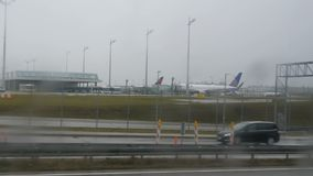 Munich, Germany - December 2, 2018: View of Munich Airport with parked planes from the window of a bus that quickly. Moves along the highway stock video