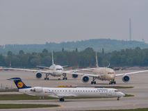 Munich, Germany / Gemany 16 May 2019 : Lufthansa Cityline jet D-ACKI is taxiing after landing at muich airport MUC stock image
