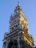 Munich, Germany - July 2015: Marienplatz clock tower in golden m Stock Images