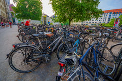 Munich, Germany - July 30, 2015: Pubic bicycle parking station with countless bikes standing lined up Stock Image