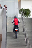 MUNICH, GERMANY - JUNE 1, 2012 :the motorcyclist shows tricks and entertains visitors at the exposition of BMW Museum Royalty Free Stock Photo