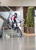 MUNICH, GERMANY - JUNE 1, 2012 :the motorcyclist shows tricks and entertains visitors at the exposition of BMW Museum Stock Photo