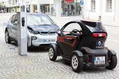 Munich, Germany- June 25, 2016: Two electric cars, Renault and BMW, being recharged at plug-in s Stock Photos