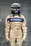 Munich, Germany - March 10, 2016: Formula One suit of BMW race car driver wearing protective leather and helmet Stock Photos