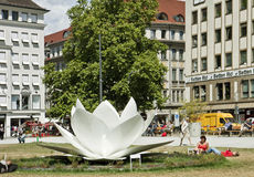 Munich, Germany - Marienhof on summer. Munich, Germany - center Munich, Marienhof on summer with a white Lotus sculpture by Korean artist Hyon Soo Kim, meant to royalty free stock photos