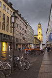 MUNICH, GERMANY - May 29, 2012: bicycles on the street Theatinerstrasse with view on Theatine Church of St. Cajetan Royalty Free Stock Image