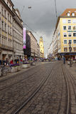 MUNICH, GERMANY - May 29, 2012: People walking through Theatinerstrasse with view on Theatine Church of St. Cajetan Stock Images