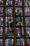 Ancient stained glass windows on a religious theme in the Cathedral of the Blessed Virgin Mary in Munich Germany. MUNICH, GERMANY - NOVEMBER 25, 2018 : Ancient stock image