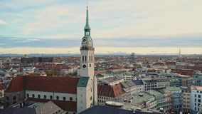 MUNICH, GERMANY - November 25, 2019: Beautiful view of the city of Munich and the clock tower of St. Peter`s Church at stock video footage