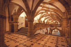 Empty hall with arches of gothic style New Town Hall, Neues Rathausbuilt in 1908. Munich. MUNICH, GERMANY - NOVEMBER 17, 2017: Empty hall with arches of gothic Stock Image