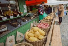 Local farmer selling potato and other vegetables at city market. MUNICH, GERMANY - NOVEMBER 16, 2017: Local farmer selling potato and other vegetables at city Stock Photo