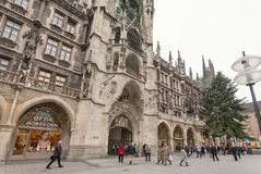 People walking past historical neo-Gothic style New Town Hall in Munich Stock Photography